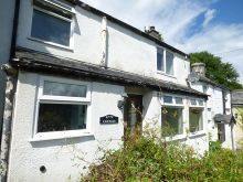 Light and airy one double bedroom cottage requiring full modernisation with a private detached garden